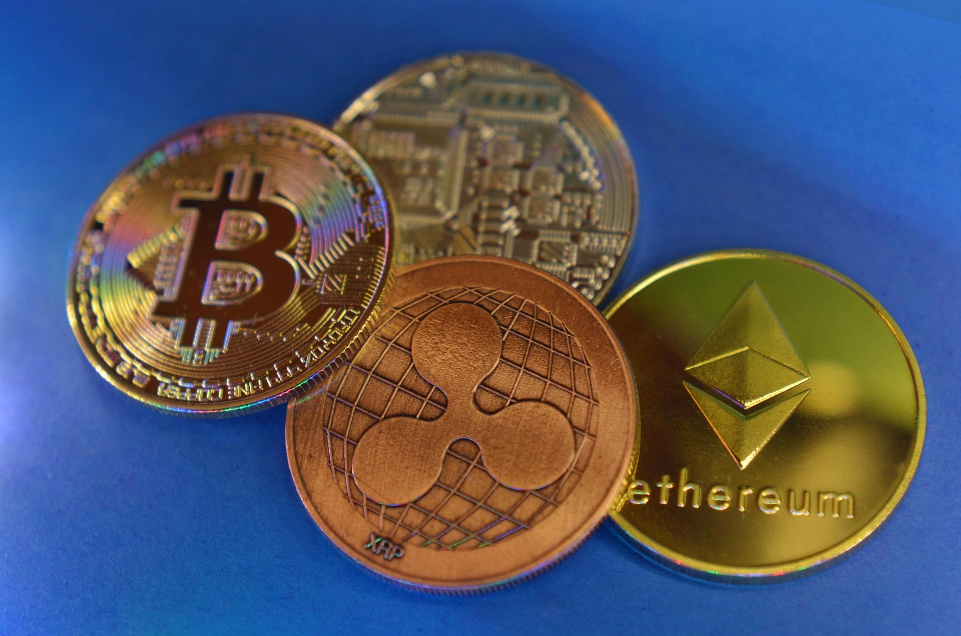 Various cryptocurrencies are displayed including (left to right) Bitcoin, XRP, and Ethereum. (Image by Miloslav Hamřík from Pixabay. )