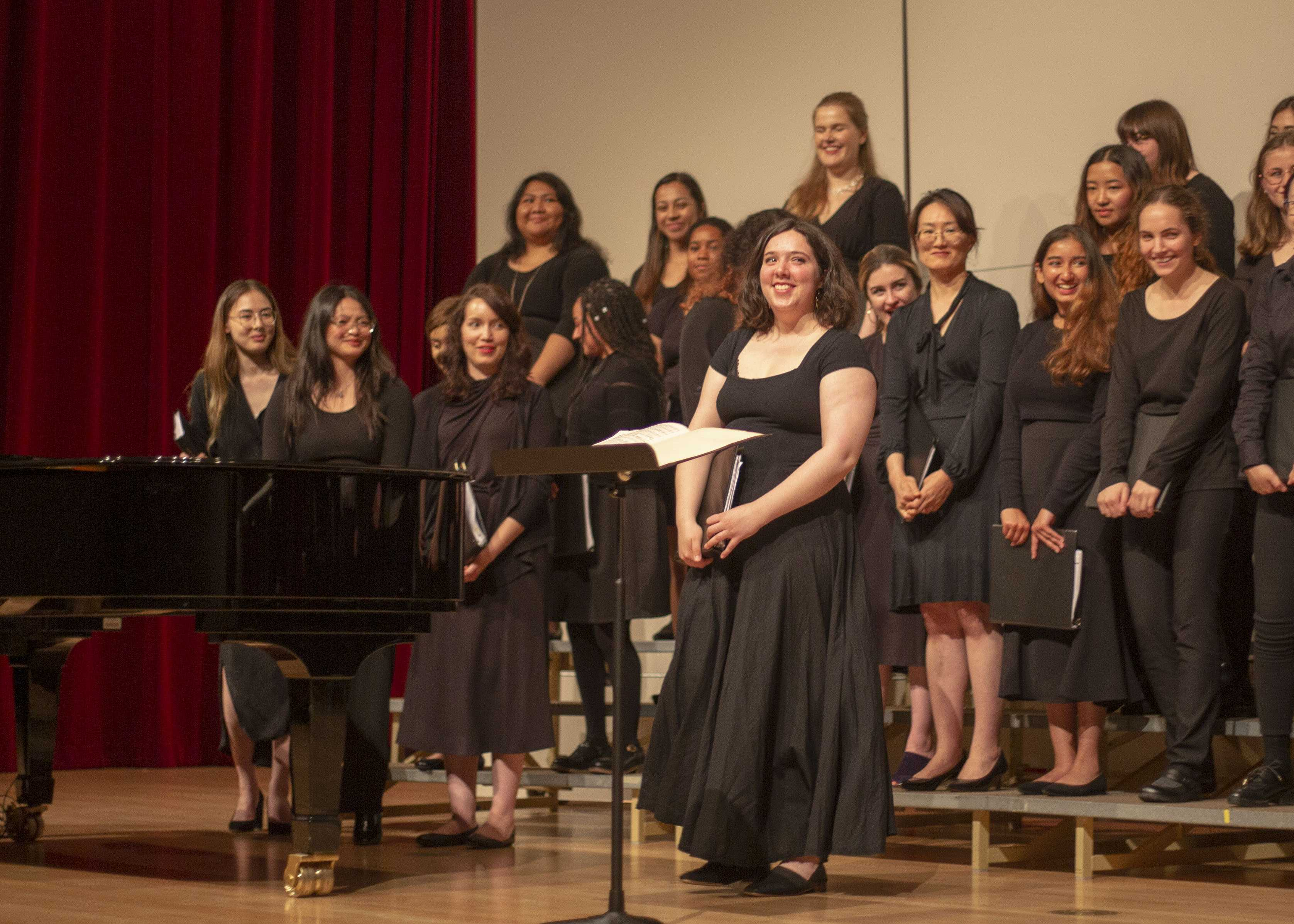 """Ana Miranda steps forward for applause at the end of """"In Paradisum"""" an opera concert by SF State's University Chorus Apr 25, 2019 (James Chan)"""