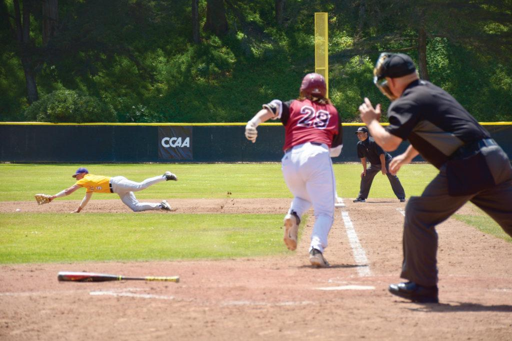 Chris+Smutney%2C+SF+State+Gators%2C++dives+to+catch+the+ball+as+Chico+State+Catcher+%09Myles+Moran+runs+towards+first+base.+