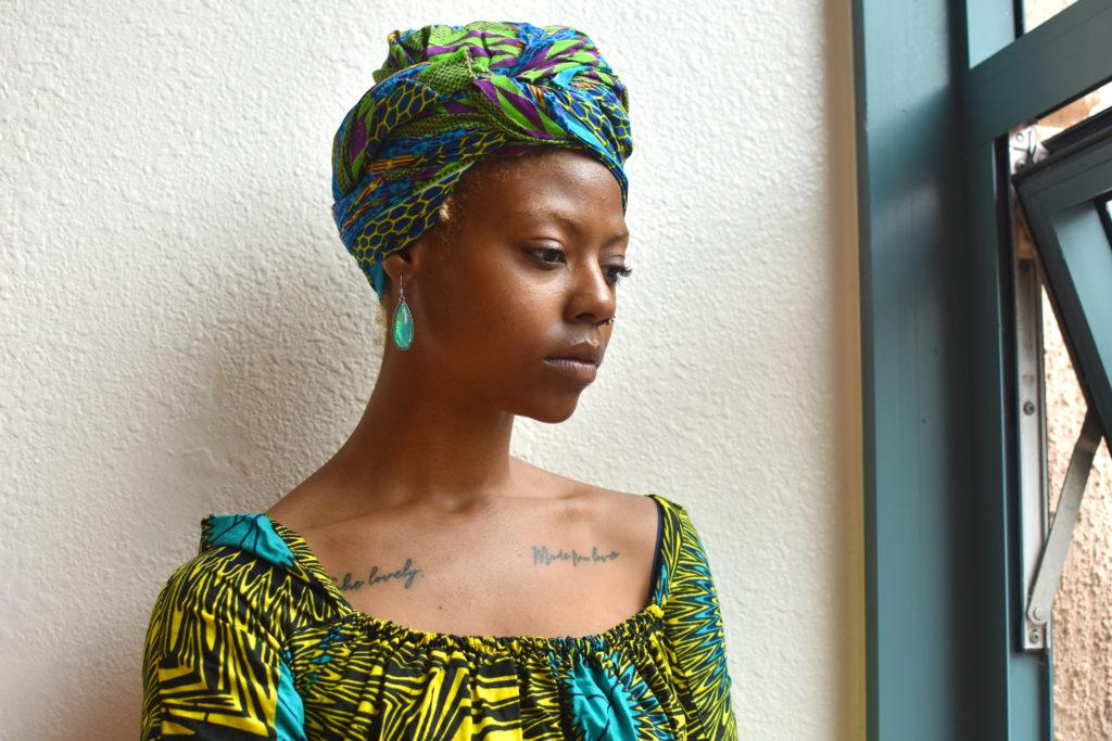 Isis Tiana Dorley, an Africana Studies student who filed a Title IX complaint against McDougal on grounds of alleged harrasment, stands for a portrait in the Humanities building on Monday, May 13, 2019. (LOLA CHASE/Golden Gate Xpress)