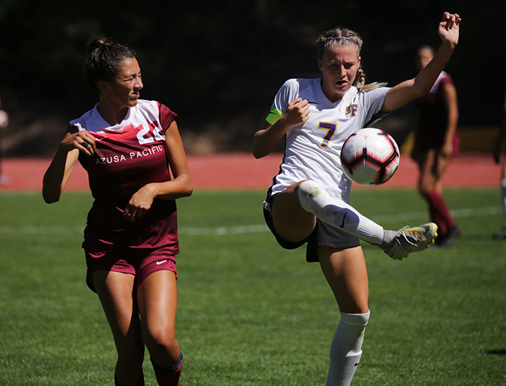 Kylie Schneider (7) attempts to control the ball with her right foot as Brianna Haskins (22) squints here eyes as the San Francisco State team face Azusa Pacific in a women's soccer game at Cox Stadium at SF State in San Francisco, Calif. on Saturday, September 21, 2019. Gators took a lose of 3-1.(Kameron Hall/ Golden Gate Xpress)
