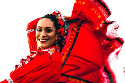 Rebeca Gonzales Estrada spins while practicing a traditional dance from Sinaloa Mexico. She and others are practicing in order to perform during Hispanic Heritage Month. Practice took place at Ocean Beach on September 26, 2019. (Photo by William Wendelman / Golden Gate Xpress)