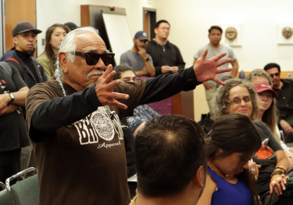 Jose Cuella, professor of Latino/Latina Studies at SF State, challenges SF District Attorney candidates to call out implicit and explicit racism as systemic white supremacy Sept. 24 (Photo by MJ Johnson / Golden Gate Xpress)