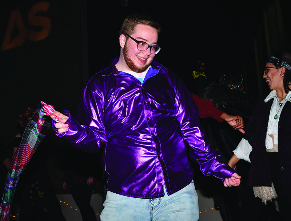 Donovan Devine, 20,  dances at the queer homecoming Saturday at Jack Adams hall in the Cesar Chavez building. (Photo by James Wyatt / Golden Gate Xpress)