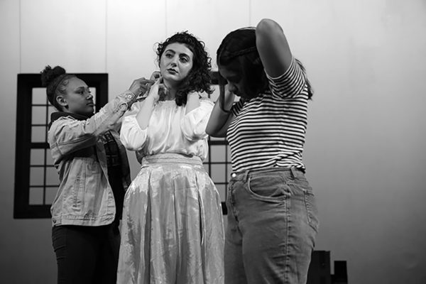 Jasmine Ashfar (left) and Tea Alexander (right) are assisted by a stage crew member before the rehearsal of Color Your World in the Little Theater on Oct. 9th, 2019. (Photo by Paige Acosta / Golden Gate Xpress)