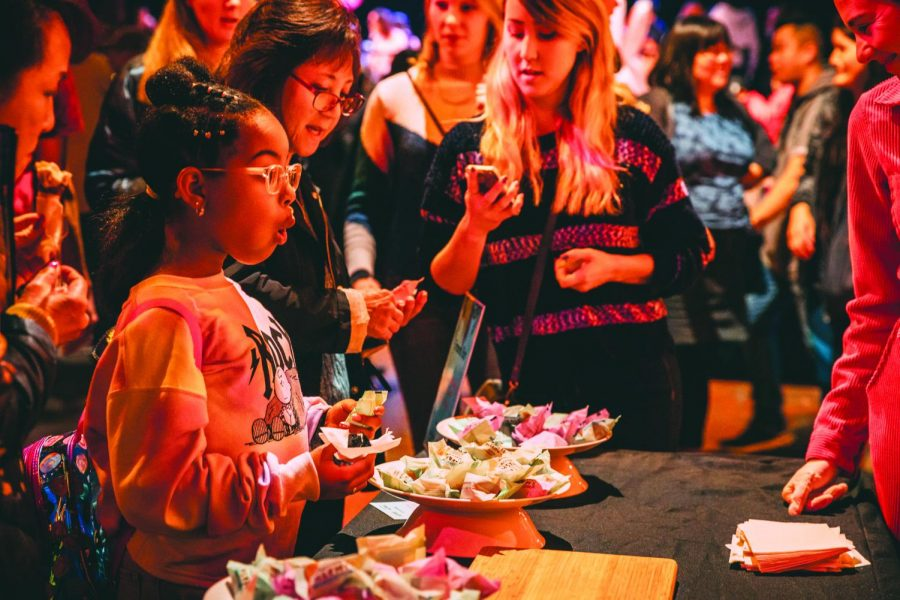Syria, daughter of Danielle Baker orders a s'more at the Smashmallow S'mores Bar during the San Francisco Food Festival on Saturday, January 25 held at SFMOMA (Photo by William Wendelman/ Golden Gate Xpress)