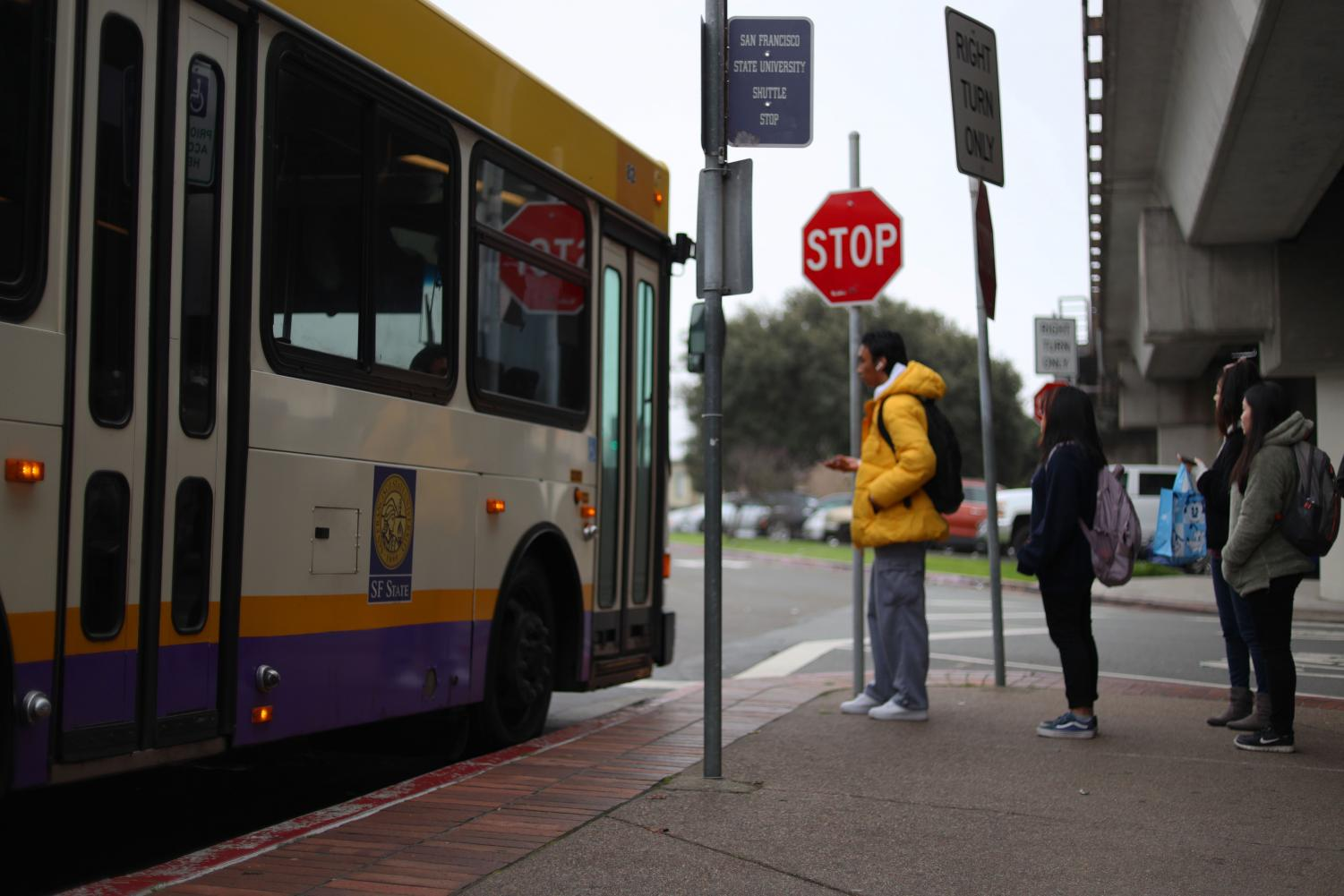 People wait in line to board the San Francisco State University shuttle bus at the Daly City Bart Station in Daly City Calif., on Monday January 27, 2020. (Emily Curiel/Golden Gate Xpress)