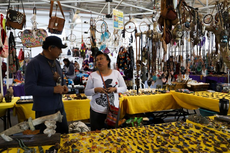 Jesus Vasquez and Sol Munoz sell handmade jewelry and pieces at the 9th annual Two-Spirit Pow Wow at the Fort Mason Festival Pavilion in San Francisco, Calif., on Saturday, February 8, 2020. (Saylor Nedelman / Golden Gate Xpress)