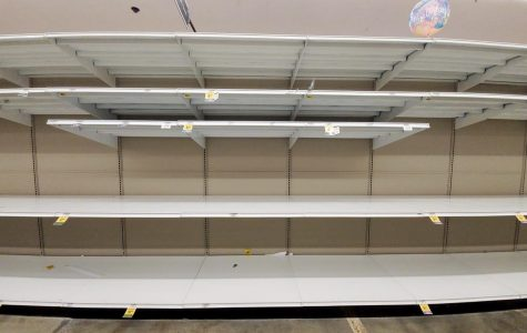 Photo of the Day: Grocery shoppers clear out shelves in panic of the coronavirus