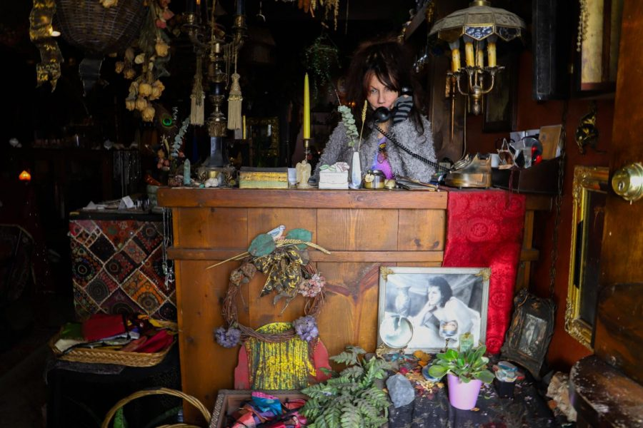 Crystal Chamber, Tarot Card reader at The Sword and Rose, takes a call on Thursday, February 27, 2020. (Saylor Nedelman / Golden Gate Xpress)