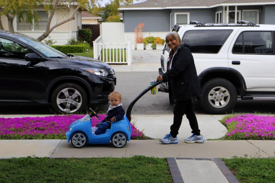 A child and their nanny take a walk in Costa Mesa, California, amid the COVID-19 pandemic on Tuesday, March 24, 2020. (Saylor Nedelman / Golden Gate Xpress)