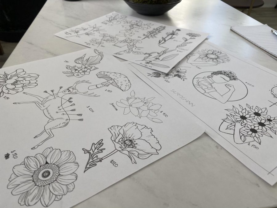 The flash sheet contains pre-designed tattoo designs known as flash tattoos for customers to select from (Jocelyn Hernandez Gomez / Golden Gate Xpress).
