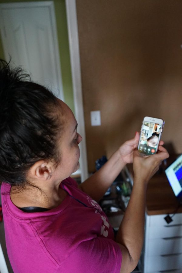 Lucy Da Silveira Facetimes her niece as well as her older son, William Ramirez while practicing social distancing during the shelter-in-place order in San Jose. ( Daniel Da Silveira / Golden Gate Xpress)
