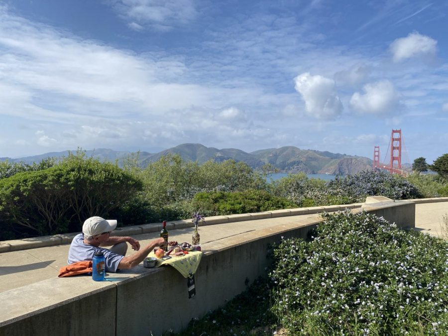 A+man+enjoys+solitude+with+a+side+of+vino+while+enjoying+a+nice+view%2C+despite+park+shutdowns+in+San+Francisco.+%E2%80%8B%28Sandy+Scarpa+%2F+Golden+Gate+Xpress%29