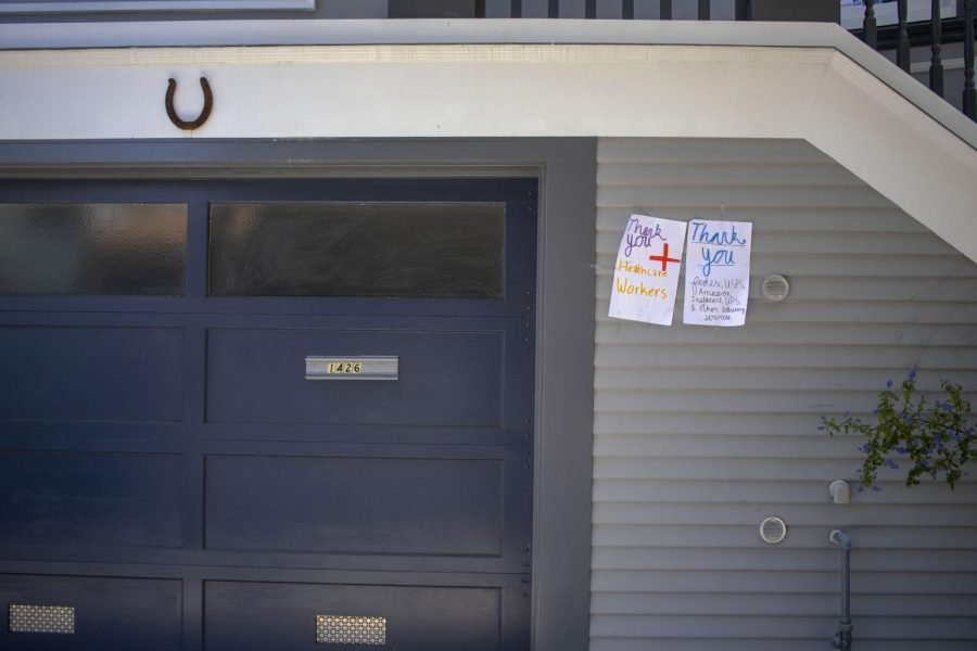 Thank you notes taped to a wall of a house in the Inner Sunset in San Francisco. (Emily Curiel / Golden Gate Xpress)