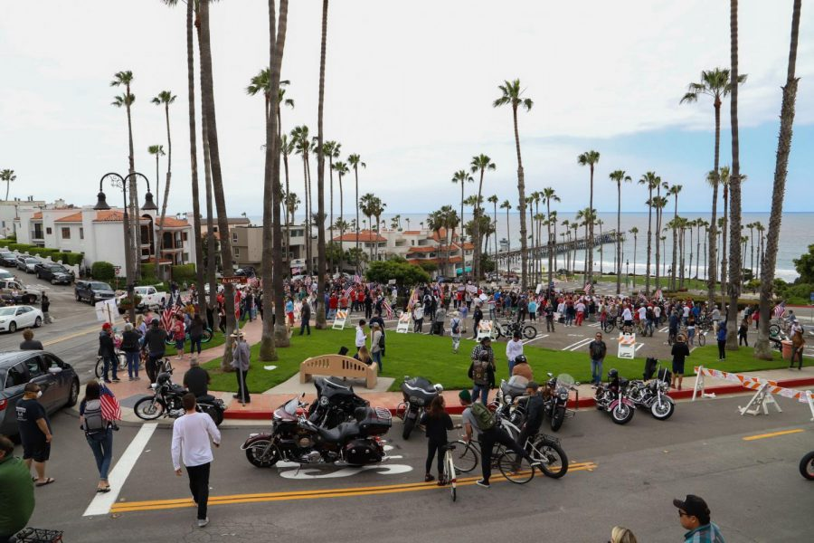 Hundreds of Orange County residents gather in downtown San Clemente, Calif., to protest the stay-at-home order on Sunday, April 19, 2020. (Saylor Nedelman / Golden Gate Xpress)