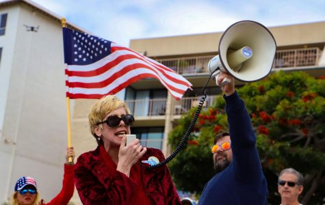 Human Rights Attorney Leigh Dundas speaks at a rally to protest the stay-at-home order in downtown San Clemente, Calif., on Sunday, April 19, 2020. (Saylor Nedelman / Golden Gate Xpress)
