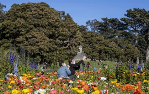 People take a selfie in front of the Conservatory of Flowers at Golden Gate Park in San Francisco California. (Emily Curiel / Golden Gate Xpress)