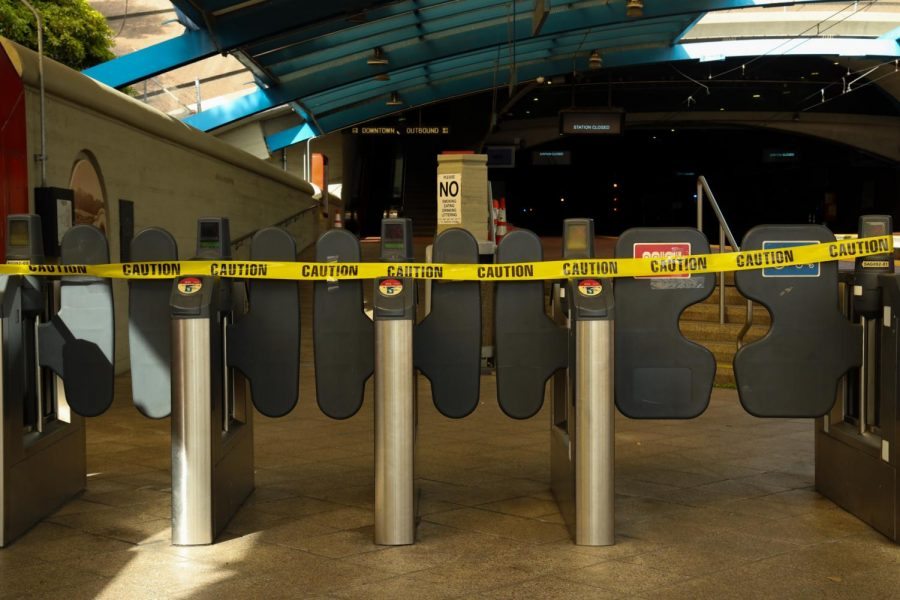West Portal Station blocked its entrance with caution tape after MTA announced light rail service was canceled indefinitely. (Dyanna Calvario / Golden Gate Xpress)