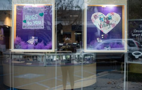 The Diamond Center filed their windows with encouraging signs, photographed in Claremont, California. (Maddison October / Golden Gate Xpress)