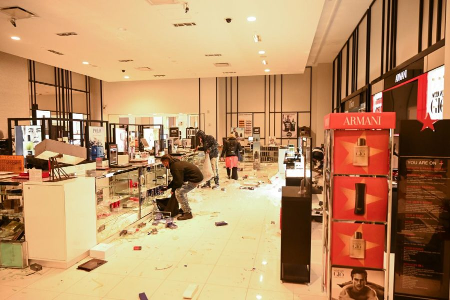 People in the Macy's store on O'Farrell street May 30, 2020 in San Francisco, Calif. after the store was broken into. Widespread vandalizing occurred throughout the city following the death of George Floyd, a detained and handcuffed black man in police custody in Minneapolis. (James Wyatt / Golden Gate Xpress)