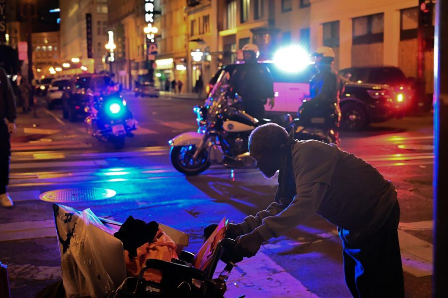 San Francisco police officers stand attentively at the corner of Grant avenue and Geary street Saturday, May 30, 2020 in San Francisco, Calif. after the Dolce & Gabbana store was broken in to following the death of George Floyd, a detained and handcuffed black man in police custody in Minneapolis. (Dyanna Calvario / Golden Gate Xpress)