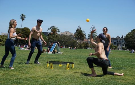 People play a game of Spikeball together without face coverings in Mission Dolores Park in San Francisco on May 9, 2020.