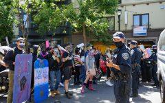 Protestors confront SFPD on Valencia street during the Pride is a Riot in San Francisco, Calif. on June 17, 2020 (Daniel Da Silveira / Golden Gate Xpress)