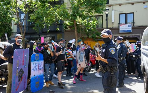 Protestors confront SFPD on Valencia street during the Pride is a Riot in San Francisco, Calif. on June 17, 2020 (Daniel Da Silveira / Golden Gate Xpress)