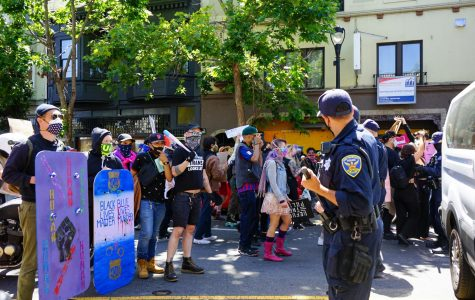 Protestors confront SFPD on Valencia street during the Pride is a Riot in San Francisco,Calif.on June 17, 2020 (Daniel Da Silveira / Golden Gate Xpress)
