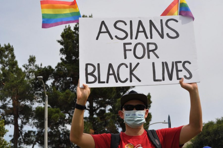 """Derrick Choi, a local high-school substitute, displayed support for the black community with an """"Asians for Black Lives"""" sign. He brought his 15-year-old son to the event and emphasized the importance of teaching young people the value of standing up for what they believe in (Chris Ramirez / Golden Gate Xpress)"""