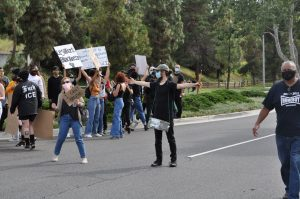 An unidentified man, who wished to be referred to as John, attempted to escalate Monday's protest, and after standing in the middle of Amar Road he led a group of protestors to the Walnut Sherrif's Department. (Chris Ramirez / Golden Gate Xpress)