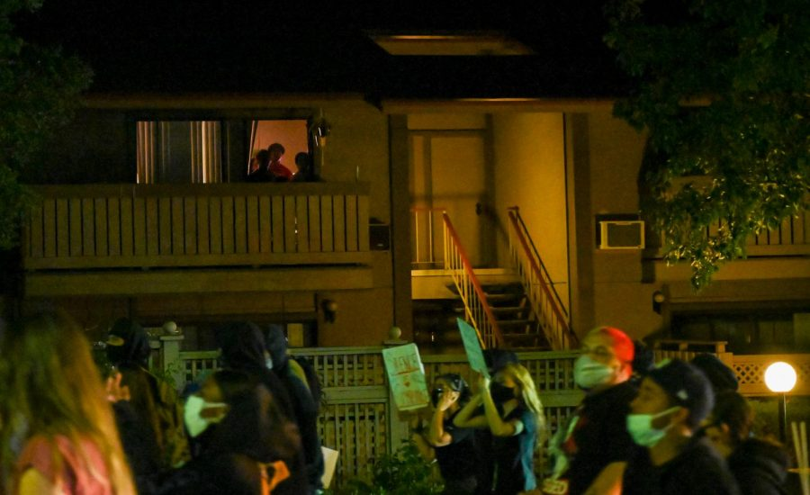 Residents of Walnut Creek watch the march from their house during the twilight protest, in Walnut Creek, Calif., on Jun. 17, 2020 (James Wyatt / Golden Gate Xpress)