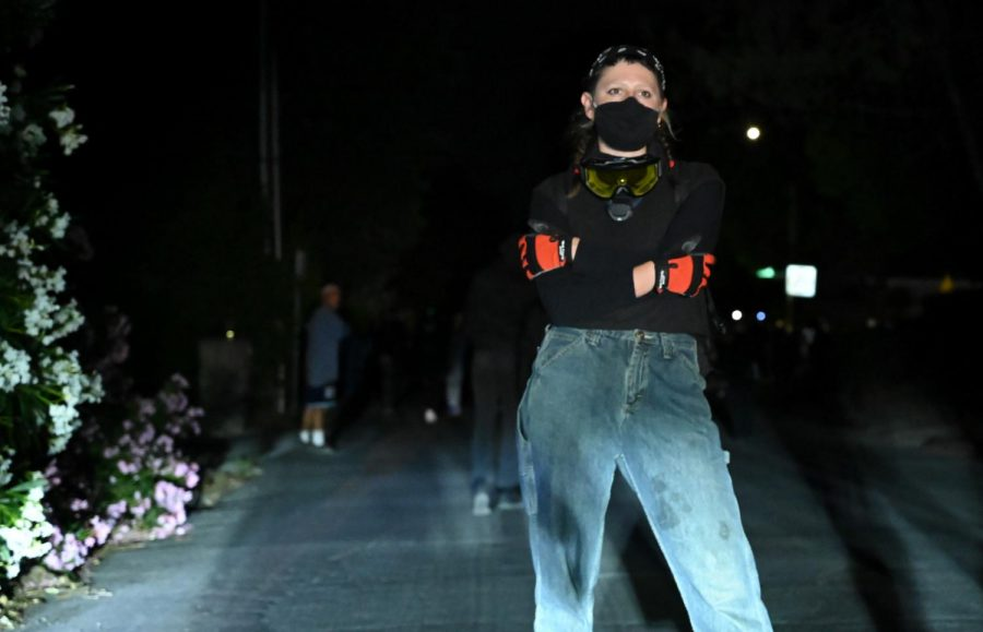 A protestor stands in the middle of the street during the twilight protest in Walnut Creek, Calif., on Jun. 17, 2020 (James Wyatt / Golden Gate Xpress)