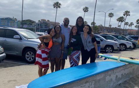 (Right to left) Gianné Nascimento, Toni Lynn Arzu, Jonathan Curtis, Vanessa Yeager, Joi K. Madison and Chase Bucklew gather in the parking lot after the paddle out. Surfers in Newport Beach organized a paddle out Saturday morning in honor of George Floyd