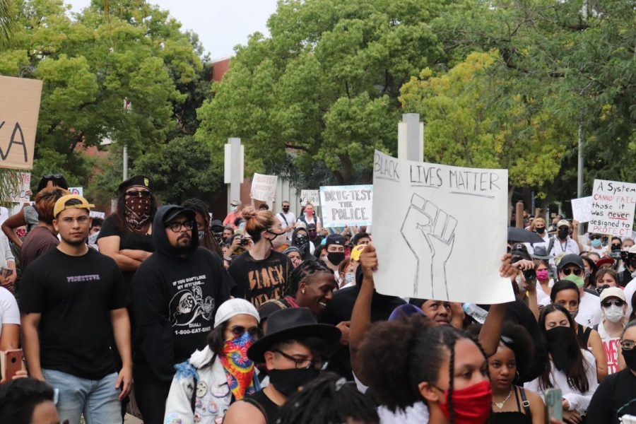 Black Lives Matter supporters join up in protest for George Floyd in front of the Fresno Police Department Headquarters on May 31. (Photo by Andrew R. Leal / Golden Gate Xpress)