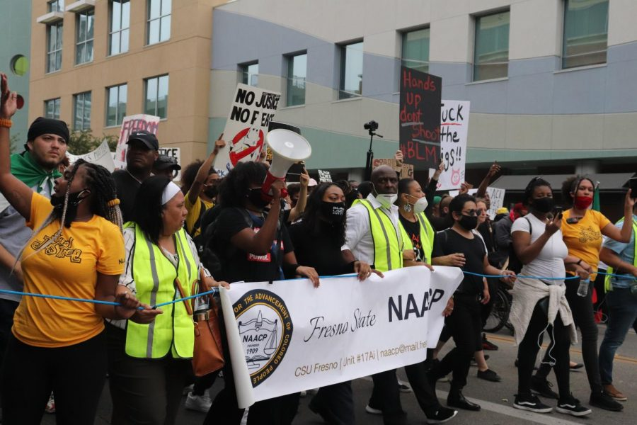 Black Lives Matter protesters led by the Fresno State NAACP march on Tulare Street in Fresno over the killing of George Floyd on May 31.(Photo by Andrew R. Leal / Golden Gate Xpress)