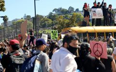 Protestors assemble throughout Dolores Park across from Mission High School in San Francisco, Calif., many holding signs on June 3, 2020. (Paisley Trent / Golden Gate Xpress)