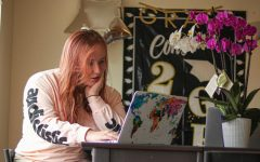 Hannah Khorassani reads about COVID-19 symptoms on her laptop, at her residence in Daly City, Calif., on July 19, 2020.) Khorassani's mother, who lives in Los Angeles, recently tested positive for COVID-19. (Harika Maddala/ Golden Gate Xpress)