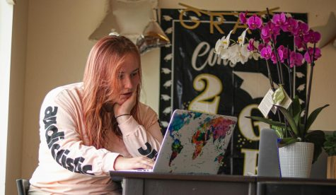 Hannah Khorassani reads about COVID-19 symptoms on her laptop, at her residence in Daly City, Calif., on July 19, 2020.) Khorassani