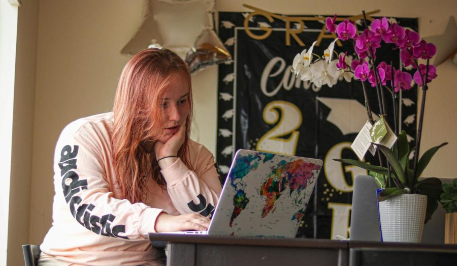 Hannah Khorassani reads about COVID-19 symptoms on her laptop, at her residence in Daly City, Calif., on July 19, 2020.) Khorassanis mother, who lives in Los Angeles, recently tested positive for COVID-19. (Harika Maddala/ Golden Gate Xpress)