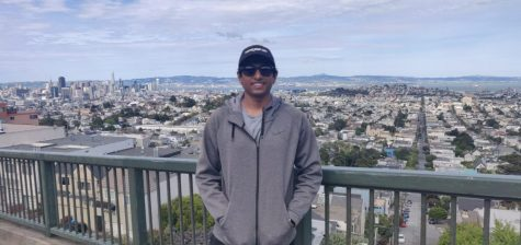 Kevin Immanuel Gubbi poses in front of a San Francisco city view. Originally from India, Gubbi stayed in San Francisco to finish his master