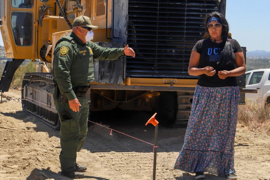 """USBP were present and alert to ensure no one who'd approached the gathering from the southern side stood across the invisible division. When anyone got close, they were approached by USBP and told to move back. Officer Masoncited USBP actions on July 25 as necessary for defending protestors' safety and """"national security.""""  (Camille Cohen/ Golden Gate Xpress)"""