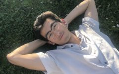 Andrew Sanders lying in the grass at Dolores Park. (Photo courtesy of Mary Evans.)
