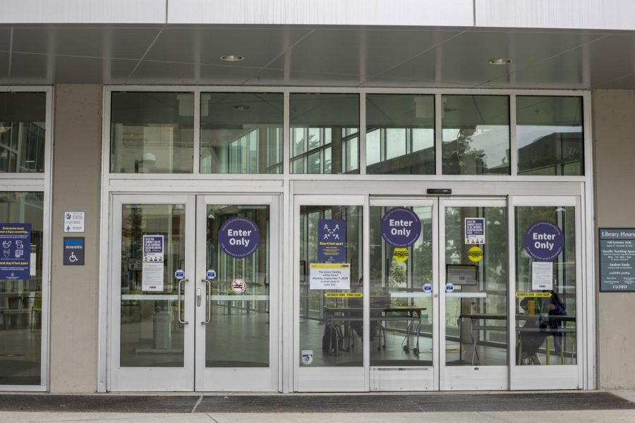 Exit-and enter-only signage are displayed on the doors of J. Paul Leonard Library at SF State.
