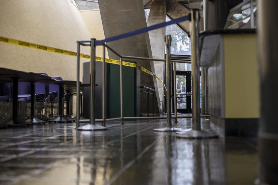 Caution tape surrounds chairs and tables around the student center to prevent people from dining indoors.