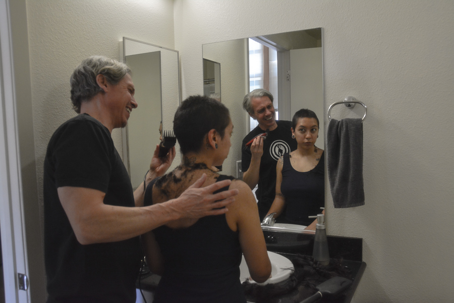In their restroom at their new apartment in Oakland, shaylyn martos and her father shave her head together while quarantining for the COVID-19 crisis. (shaylyn martos/Golden Gate Xpress)