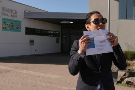 Tuan Nguyen prepares to turn in his ballot on Election Day at the Ortega Branch Library. Kassiola