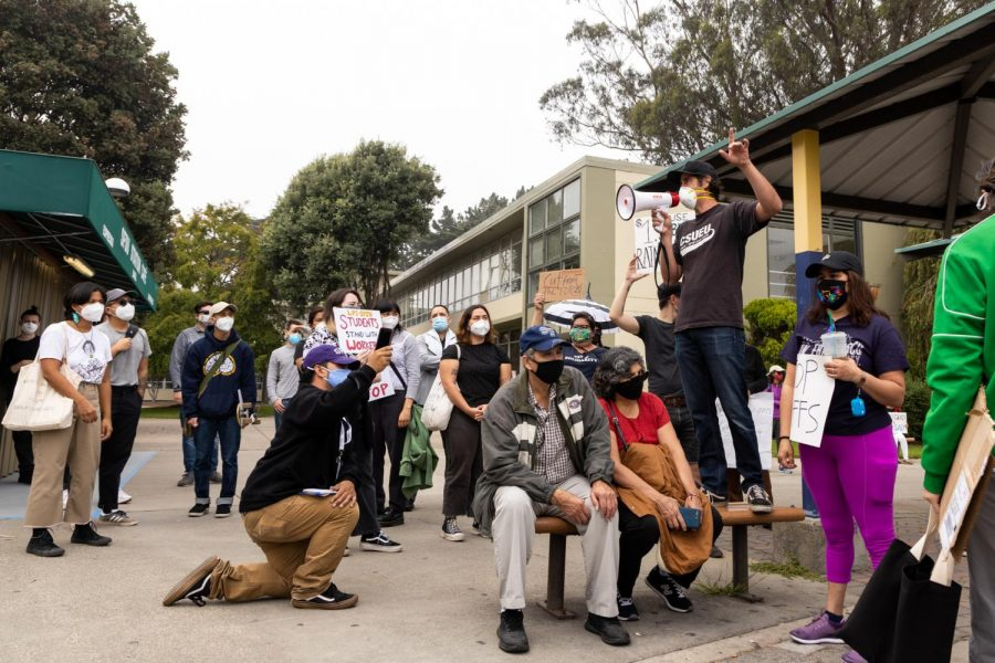 The San Francisco State University Worker Defense Coalition and supporters gather in front of the SF State campus to protest against the recent layoff notice of 131 staff members. (Jun Ueda / Xpress Media)