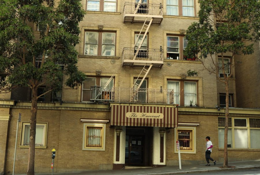 A man walks past the Harcourt Hotel on Larkin Street, a single room occupancy hotel that houses low income San Franciscans. While SROs saw a drop in new daily cases in June, case numbers saw a steady increase in July and fluctuating numbers in August. The second largest case increase in a single day occurred July 21 with 23 new cases, followed by Aug. 6, the third highest, with 21 new cases. ( Golden Gate Xpress / San Francisco, CA., September 3, 2020).